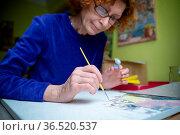 Age, retirement, creativity, imagination and art. Creative work. Caucasian... Стоковое фото, фотограф Zoonar.com/Yelizaveta Tomashevska / easy Fotostock / Фотобанк Лори