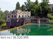 Castle like Hydroelectric power plant Ozalj1 was built in 1908 and... Стоковое фото, фотограф Zoonar.com/Borislav Marinic / easy Fotostock / Фотобанк Лори