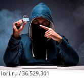 The computer hacker working in dark room. Стоковое фото, фотограф Zoonar.com/Elnur Amikishiyev / easy Fotostock / Фотобанк Лори