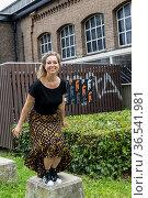 Tilburg, Netherlands. Women's Fashion Designer, Suzanne Buker, jumping... Стоковое фото, фотограф Guido Koppes / age Fotostock / Фотобанк Лори