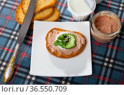 Canape with pate and young cheese and tomatoe at bread, served on desk. Стоковое фото, фотограф Яков Филимонов / Фотобанк Лори