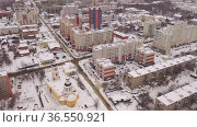 Aerial view of the Intercession Bishop Cathedral and residental quarters in winter in city Penza, Russia. Стоковое видео, видеограф Яков Филимонов / Фотобанк Лори
