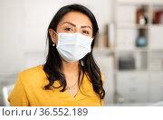 Confident businesswoman in medical mask inviting to office. Стоковое фото, фотограф Яков Филимонов / Фотобанк Лори
