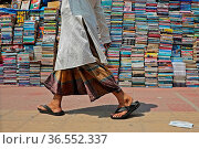 Piled up books are mounting up that have been auctioning off at very... Редакционное фото, фотограф Eyepix / WENN / age Fotostock / Фотобанк Лори