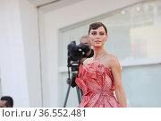 Catrinel Marlon during the Red carpet at the 78th Venice Film Festival... Редакционное фото, фотограф Mirco Toniolo / AGF/Mirco Toniolo / AGF / age Fotostock / Фотобанк Лори