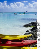 Canoes and boats for hire at public beach of Péreybère, Mauritius. Стоковое фото, фотограф Mehul Patel / age Fotostock / Фотобанк Лори