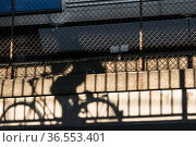 Stockholm, Sweden The shadow of a bicyclist on a wall of an underpass... Стоковое фото, фотограф A. Farnsworth / age Fotostock / Фотобанк Лори