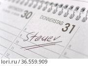 Steuertermin im Kalender markiert. Стоковое фото, фотограф Zoonar.com/Wolfilser / easy Fotostock / Фотобанк Лори