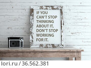 Inspirational quote on picture frame. If you can?t stop thinking about... Стоковое фото, фотограф Zoonar.com/Roberto Rizzo / easy Fotostock / Фотобанк Лори