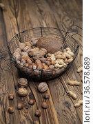 Still life with hazelnut peanuts walnut and coconut on wooden board. Стоковое фото, фотограф Richard Semik / easy Fotostock / Фотобанк Лори