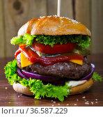 Delicious tasty hamburger with beef cutlet, fresh vegetables and cheese. Стоковое фото, фотограф Яков Филимонов / Фотобанк Лори