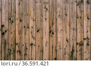 The texture of dark wooden planks knocked down in an upright position... Стоковое фото, фотограф Zoonar.com/Nadtochiy Vladimir / easy Fotostock / Фотобанк Лори