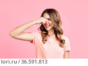 Smells bad, woman pinching nose with disgust on pink background. face... Стоковое фото, фотограф Zoonar.com/Viktor Gladkov / easy Fotostock / Фотобанк Лори