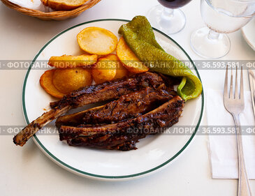 BBQ veal ribs with fried potatoes and baked pepper