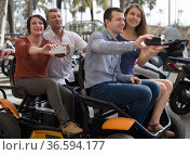 family of tourists enjoy a walk on the bike carriage. Стоковое фото, фотограф Татьяна Яцевич / Фотобанк Лори