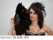 Burlesqueportrait einer perfekt geschminkten und gestylten jungen Frau. Стоковое фото, фотограф Zoonar.com/Hans Eder / age Fotostock / Фотобанк Лори