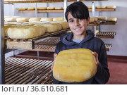 Boy holding a cheese, Es Tudons cheesemaking, Ciutadella, Menorca... Редакционное фото, фотограф Tolo Balaguer / age Fotostock / Фотобанк Лори
