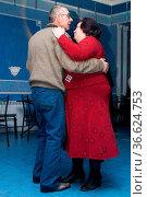 Man and woman dancing in a cafe happy couple. Стоковое фото, фотограф Zoonar.com/Volodymyr Khodariev / easy Fotostock / Фотобанк Лори