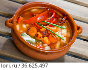 Soup of bean with boiled carrots, pepper and greens, served in bowl. Стоковое фото, фотограф Яков Филимонов / Фотобанк Лори