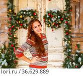 Portrait of the happy teen girl by the Christmas decorations. Стоковое фото, фотограф Zoonar.com/Dasha Petrenko / easy Fotostock / Фотобанк Лори