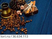 Coffee beans, anise, cinnamon, turk, present box and cones on dark... Стоковое фото, фотограф Zoonar.com/Violeta Melnyk / easy Fotostock / Фотобанк Лори