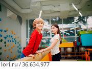 Kids doing balance beam gymnastics exercises in gym at kindergarten... Стоковое фото, фотограф Zoonar.com/Max / easy Fotostock / Фотобанк Лори