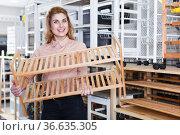 Girl looking for shoe rack in shop. Стоковое фото, фотограф Яков Филимонов / Фотобанк Лори