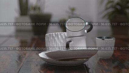 Still life with dishware under the rain