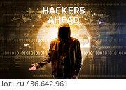 Faceless hacker at work with HACKERS AHEAD inscription, Computer security... Стоковое фото, фотограф Zoonar.com/ranczandras / easy Fotostock / Фотобанк Лори