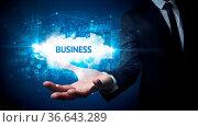 Hand of Businessman holding BUSINESS inscription, successful business... Стоковое фото, фотограф Zoonar.com/rancz / easy Fotostock / Фотобанк Лори