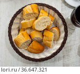Sliced french baguette on plate in restaurant. Стоковое фото, фотограф Яков Филимонов / Фотобанк Лори