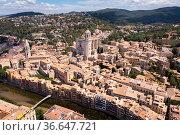 View from drone of Girona on bank of Onyar river. Стоковое фото, фотограф Яков Филимонов / Фотобанк Лори