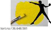 Silhouette of female handball player against yellow paint stain and paint brush on white background. Стоковое фото, агентство Wavebreak Media / Фотобанк Лори