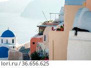 Oia Santorini Greece famous with romantic and beautiful sunsets. Стоковое фото, фотограф Zoonar.com/Desislava Vasileva / easy Fotostock / Фотобанк Лори