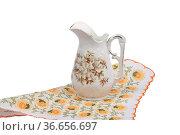 Alte Blumenvase auf Tuch - Old flower vase on cloth. Стоковое фото, фотограф Zoonar.com/lantapix / easy Fotostock / Фотобанк Лори