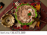 Oriental dish of boiled meat and dough on a tablecloth. Стоковое фото, фотограф Zoonar.com/Albert Karimov / easy Fotostock / Фотобанк Лори