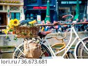 Bicycle on the city street river channel bridge in Amsterdam. Стоковое фото, фотограф Zoonar.com/Yuri Dmitrienko / easy Fotostock / Фотобанк Лори
