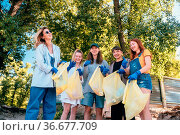 Group of activists friends collecting plastic waste on the beach.... Стоковое фото, фотограф Zoonar.com/Oleksii Hrecheniuk / easy Fotostock / Фотобанк Лори