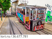 Tram running on the street in Lisbon, Portugal. Стоковое фото, фотограф Zoonar.com/Chun Ju Wu / easy Fotostock / Фотобанк Лори