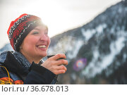 Beautiful Caucasian girl is holding a cup of tea outdoors, winter time. Стоковое фото, фотограф Zoonar.com/Patrick Daxenbichler / easy Fotostock / Фотобанк Лори