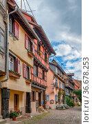 Picturesque historical street in Eguisheim, Alsace, France. Стоковое фото, фотограф Zoonar.com/Boris Breytman / easy Fotostock / Фотобанк Лори