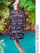 Famous signs of Kroya waterfall in nothern Bali, Indonesia. Стоковое фото, фотограф Zoonar.com/Piotr Stryjewski / easy Fotostock / Фотобанк Лори