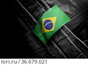 Tag on dark clothing in the form of the flag of the Brazil. Стоковое фото, фотограф Zoonar.com/BUTENKOV ALEKSEY / easy Fotostock / Фотобанк Лори