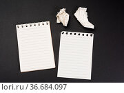 Notebook with white sheets in a line on a black background, close up. Стоковое фото, фотограф Zoonar.com/Danko Natalya / easy Fotostock / Фотобанк Лори