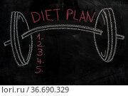 Barbell and diet plan list drawn with chalk on blackboard. Стоковое фото, фотограф Zoonar.com/Piotr Stryjewski / easy Fotostock / Фотобанк Лори
