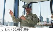 Man wearing VR headset. Стоковое видео, агентство Wavebreak Media / Фотобанк Лори