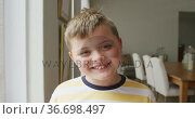 Portrait of caucasian boy smiling while standing in the living room at home. Стоковое видео, агентство Wavebreak Media / Фотобанк Лори