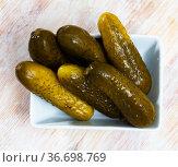 Pickled cucumbers on a plate. Стоковое фото, фотограф Яков Филимонов / Фотобанк Лори