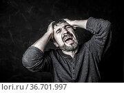 Portrait of a man who shouts from the experiences. Стоковое фото, фотограф Zoonar.com/Lyubov Pimenova / age Fotostock / Фотобанк Лори