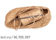 Hand-knitted bottom of bag with spool of hemp twine and crochet isolated... Стоковое фото, фотограф Zoonar.com/Valery Voennyy / easy Fotostock / Фотобанк Лори